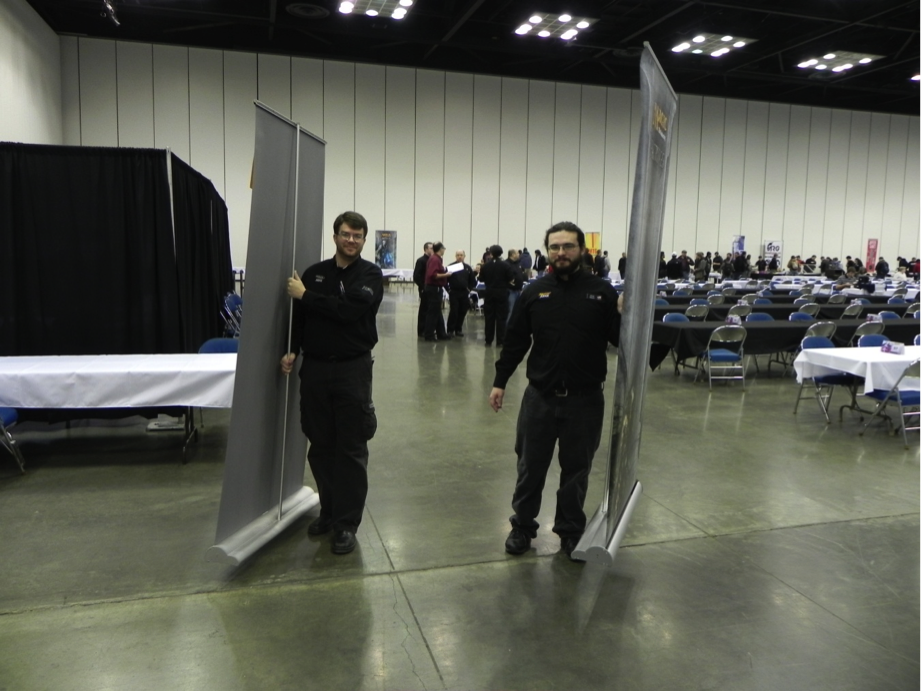The paper team distributing pairing boards