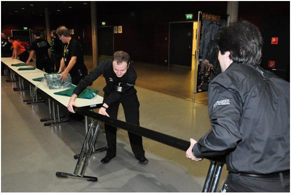 Pierre Laquerre and Ivan Morel setting up a table at GP—Bochum '10