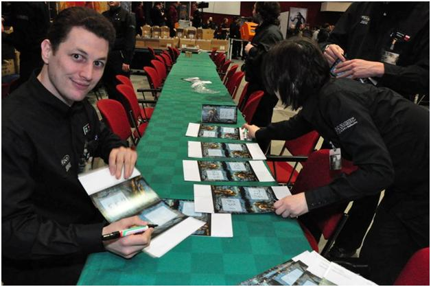 Jeremie Granat and Claire Dupré writing table numbers at GP—Bochum '10