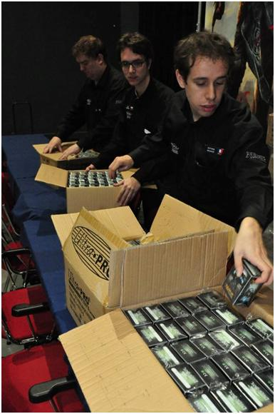 Thomas Frank, Joep Verhoeven and Antoine Bouaziz preparing deck boxes at GP—Bochum '10