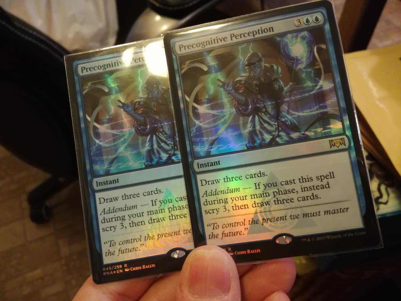 Two foil cards, side by side