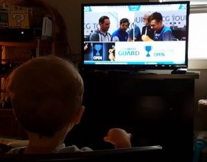 Theo watching his dad as he is on event coverage