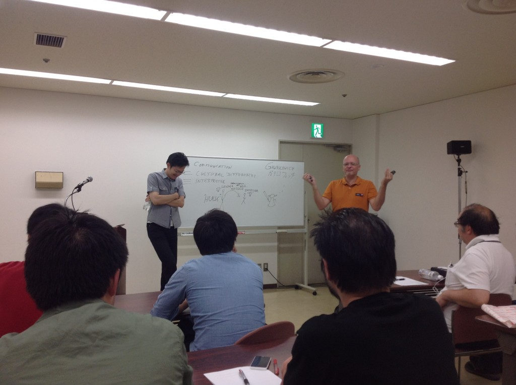 We interrupt the questions with a picture of Christian Gawrilowicz (L3) giving a seminar at the conference with Kenji Suzuki (L3) translating.